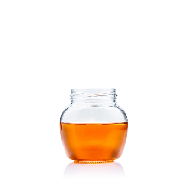 Honey in glass jar on white background with copy space Premium Photo