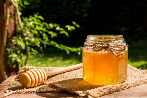 Honey jar outdoors Premium Photo