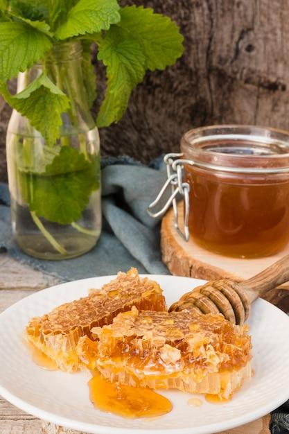 Honey jar with honeycomb pieces Free Photo