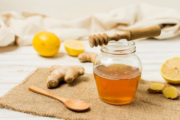 Honey jar with lemon and ginger Free Photo