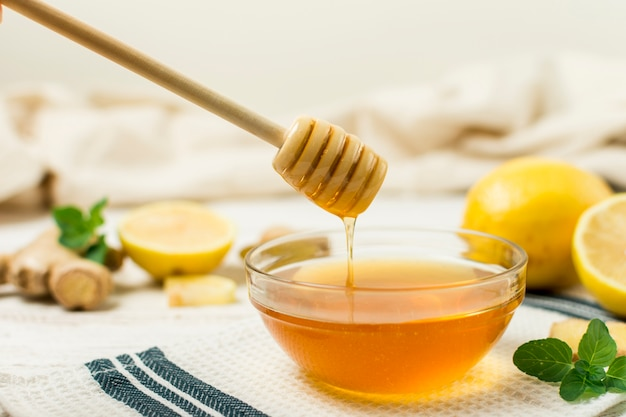 Honey jar with spoon Free Photo