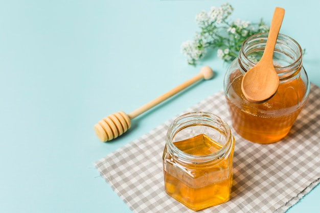 Honey jars with spoons Free Photo
