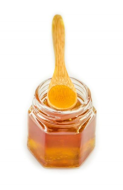 Honey on a white background. selective focus. food. Premium Photo
