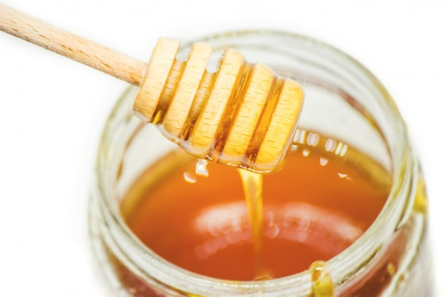 Honey on a white background. selective focus. food. Premium Photo