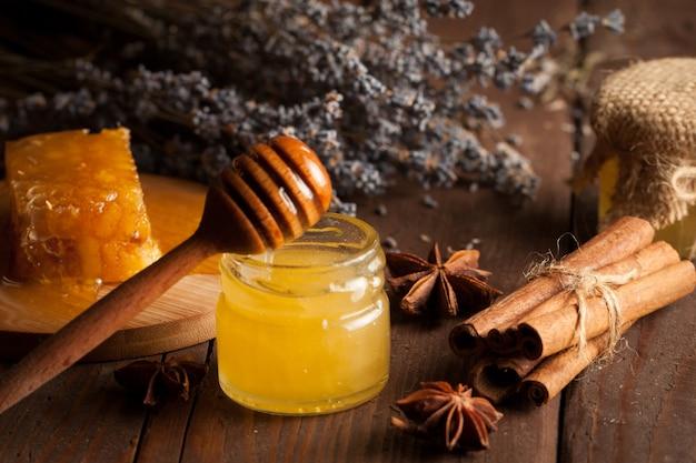 Honey on wooden background. Premium Photo
