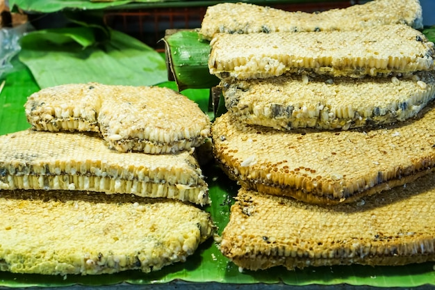 Honeycomb on a banana leaf in the market. Premium Photo