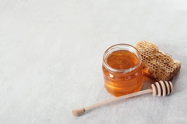 Honeycomb with jar Free Photo