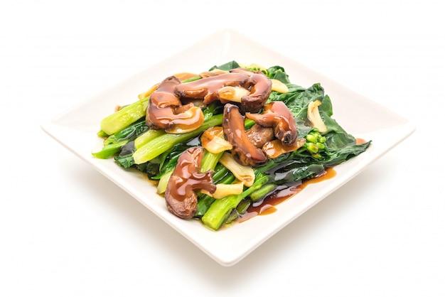 Hong kong kale stir fried in oyster sauce with garlic Premium Photo