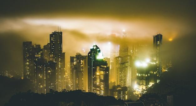 Hong kong skyline from victoria peak on a foggy misty night Premium Photo