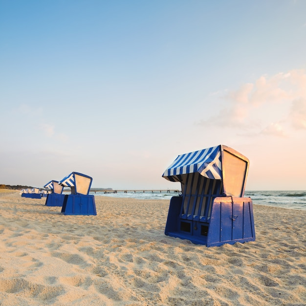 Hooded beach chairs on island rugen Premium Photo