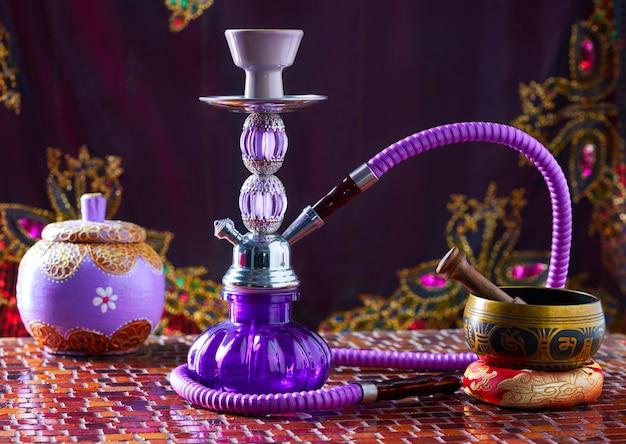 Hookah shisha smoke and singing bowl Premium Photo