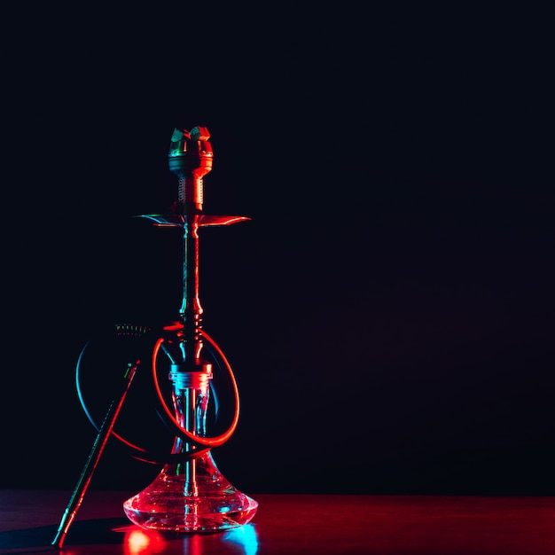 Hookah shisha with coals on the table Premium Photo