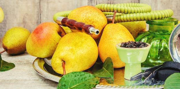 Hookah. tobacco flavor of pear. food nature. Premium Photo