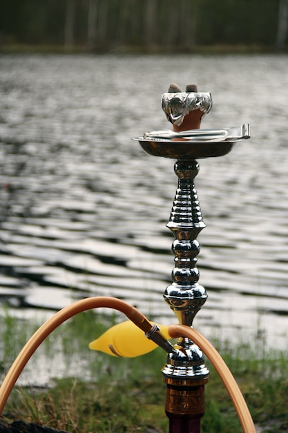 Hookah with yellow ice pipe Free Photo