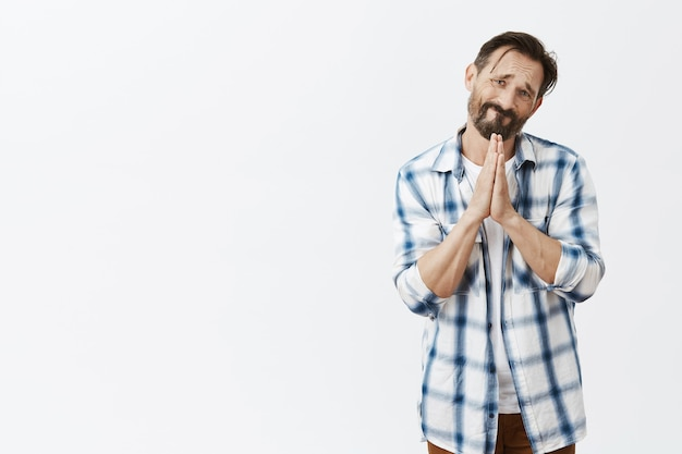 Hopeful bearded mature man posing Free Photo