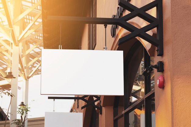 Horizontal black empty signage on clothes shop front with copy space. Premium Photo