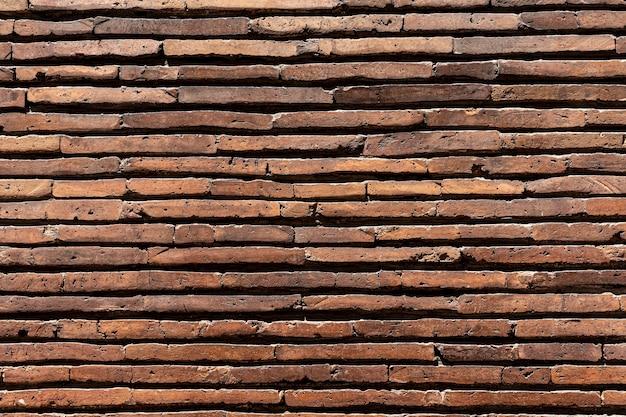水平方向の茶色のレンガの壁の背景 無料写真