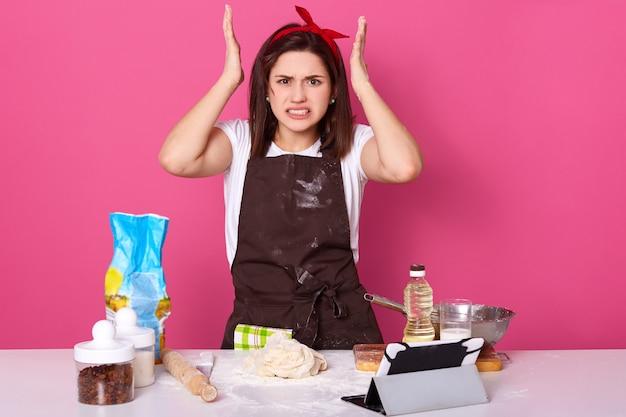 Horizontal shot of angry housewife Premium Photo