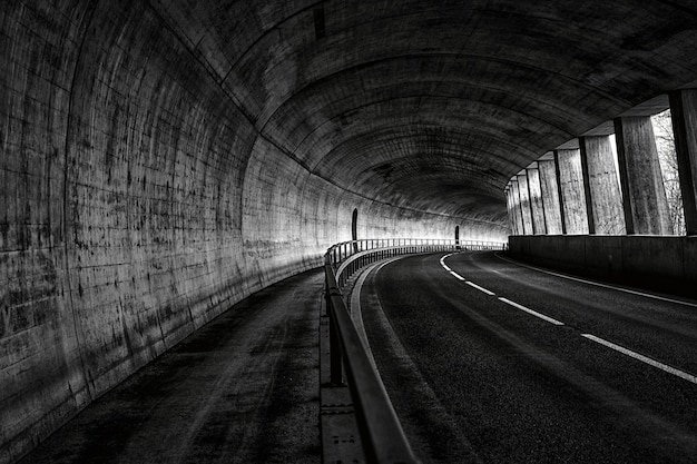 Horizontal view of an empty road in the tunnel Free Photo