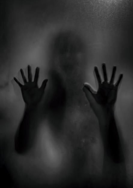 Horror ghost girl behind the matte glass in black and white. halloween festival concept. Premium Photo