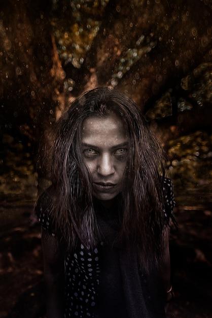 Horror scene of a possessed woman black long hair ghost halloween concept Premium Photo