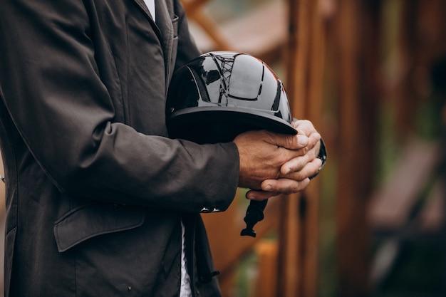 Horse man holding his helmet Free Photo