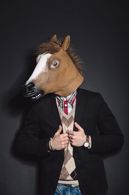 Horse mask man in studio Free Photo