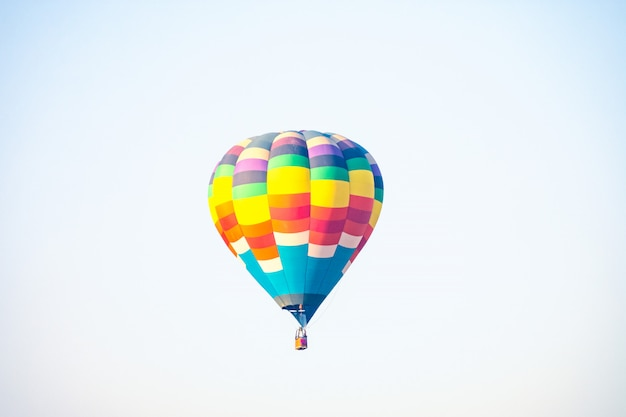 Hot air balloon over the green paddy field. composition of nature and white background. Premium Photo