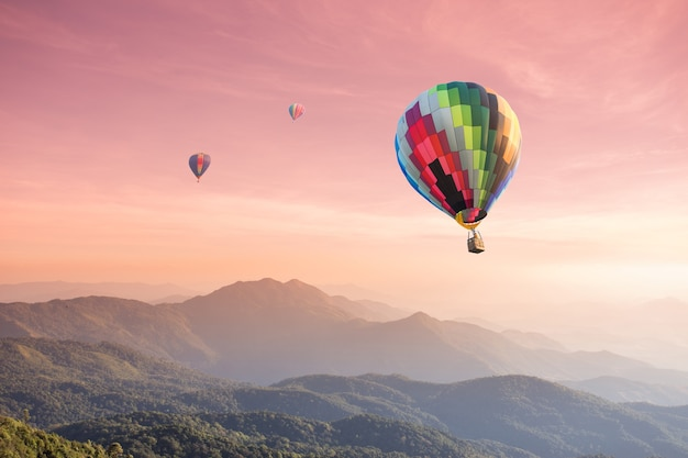 Hot air balloon over high mountain at sunset Premium Photo