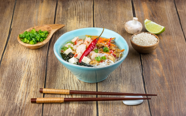 Hot asian soup with tofu Premium Photo