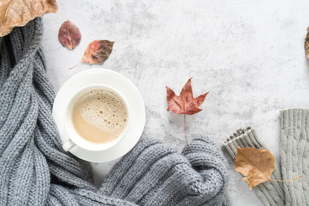 Hot beverage with warm sweater on light surface Free Photo