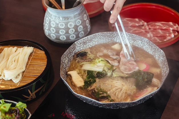 Hot and boiling shabu broth with cabbage Premium Photo