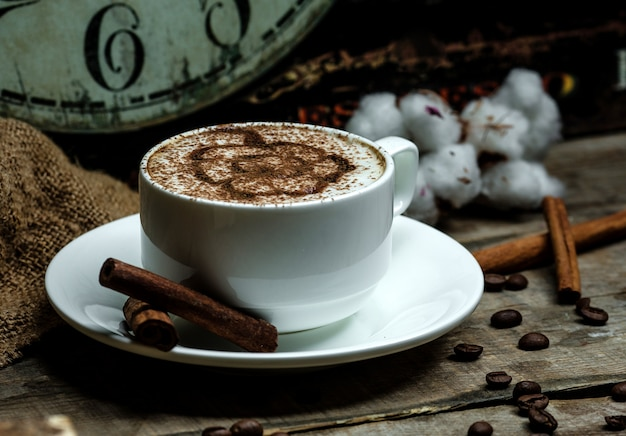 Hot cappuccino glass with cinnamon pattern Free Photo