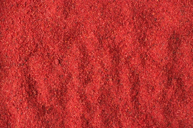 Hot chili pepper powder spice as a background, natural seasoning texture Premium Photo