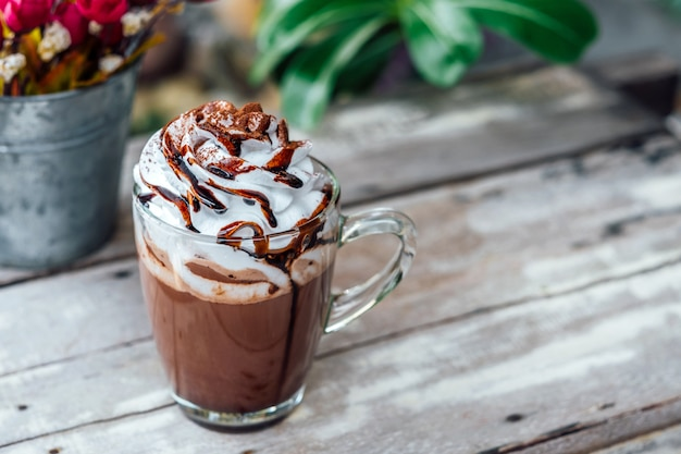 Hot chocolate cocoa in glass mug with whipped cream Premium Photo