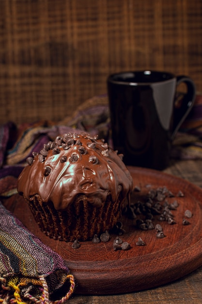 Hot chocolate mug and muffin on wood board Free Photo