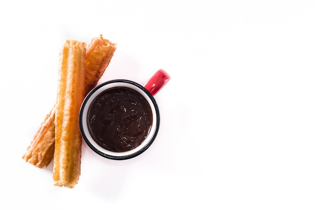 Hot chocolate with churros isolated on white background top view copy space Premium Photo