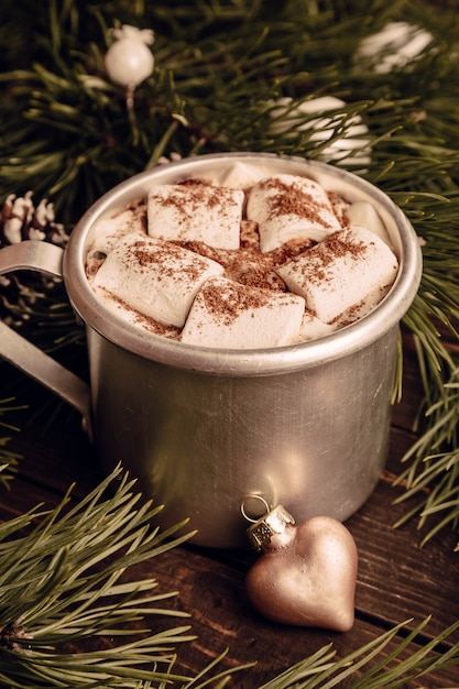 Hot chocolate with marshmallow and fir branches Premium Photo