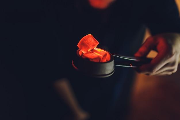 Hot coals for smoking Premium Photo