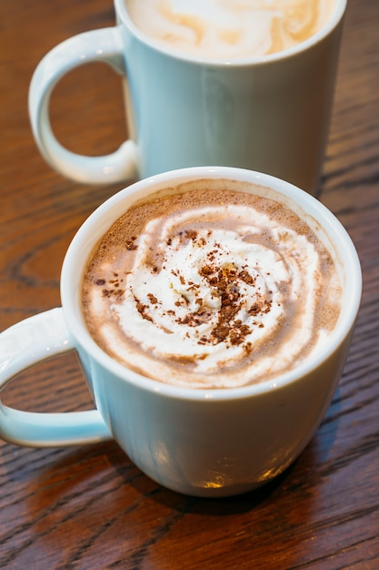 Hot cocoa and chocolate in white cup or mug Free Photo