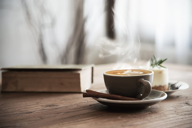 Hot coffee cup set on wooden table Free Photo