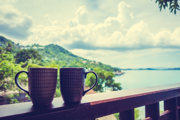 Hot coffee cup with beautiful tropical outdoor view Free Photo