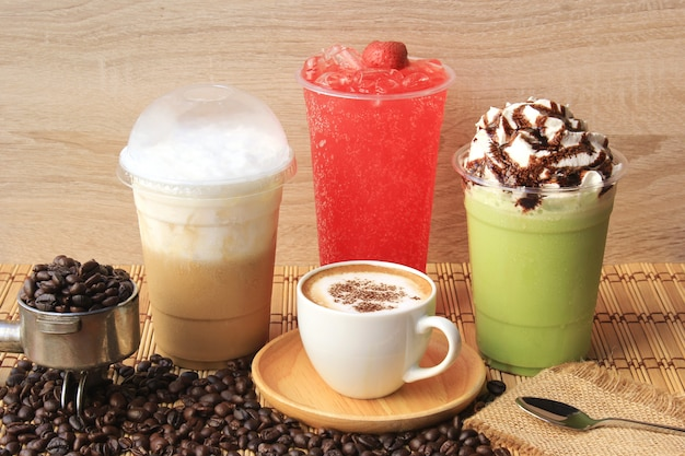 Hot coffee cup with coffee beans on the wooden table, cold coffee, iced matcha green tea and fruit soda for summer drink Premium Photo