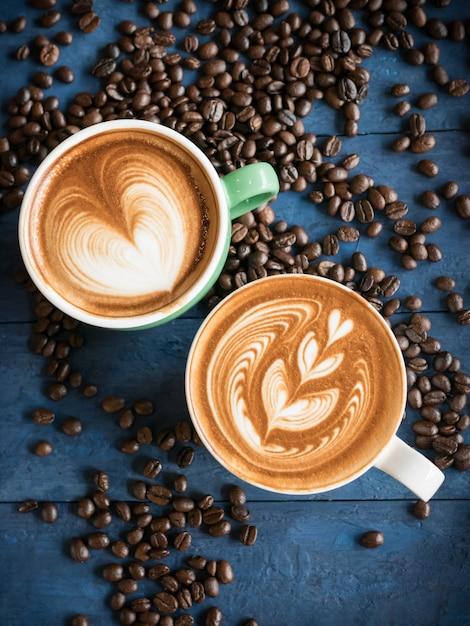 Hot coffee in a cup with foam milk Premium Photo