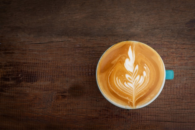Hot coffee with latte art. favorite caffeine beverage. refreshment drink in morning. Premium Photo