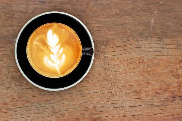 Hot coffee with latte art. favorite caffeine beverage. refreshment drink in morning. Premium Photo