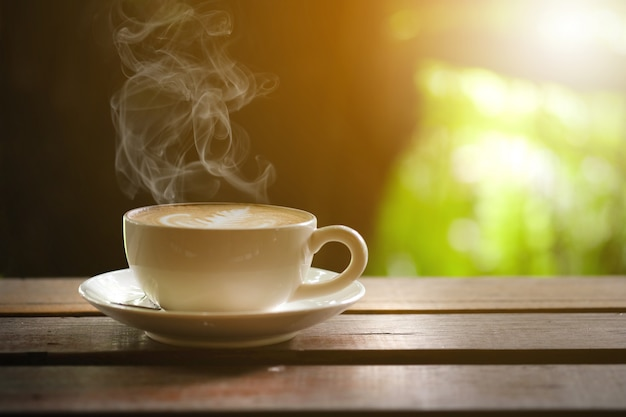 Hot coffee on wooden table on the terrace. Premium Photo