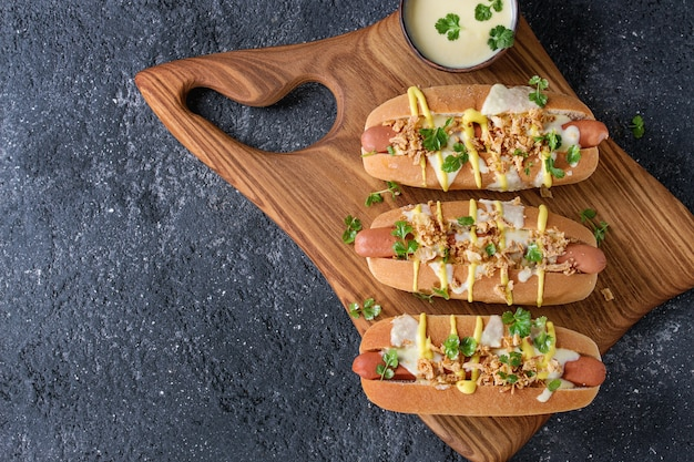 Hot dogs with cheese sauce and mustard Premium Photo
