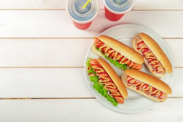 Hot dogs on wooden background Premium Photo