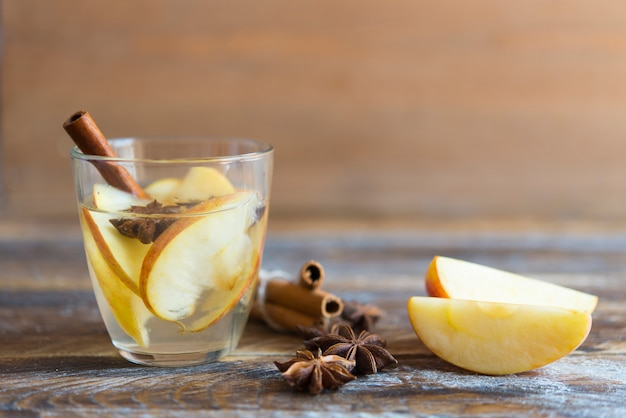 Hot drink with apples for autumn or winter holidays. Premium Photo